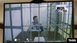Ukrainian army pilot Nadezhda Savchenko is seen on a monitor during a video link at a hearing in a Moscow court on February 25.
