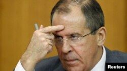 Russian Foreign Minister Sergei Lavrov gestures during a news conference in Moscow on January 18.