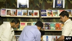 Browsing the offerings at the stand of Lebanon's Hizballah at Iran's international book fair in Tehran recently