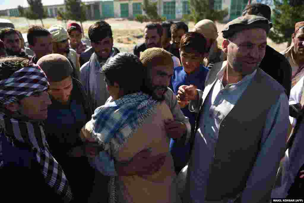 A freed Taliban member hugs relatives after his release from Bagram prison on May 25.