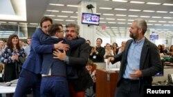 U.S. -- New York Times fotoqrafları Daniel Etter, Sergei Ponomaryov, Mauricio Lima və Tyler Hicks (sol-sağ) mükafat qazanıb, aprel 2016