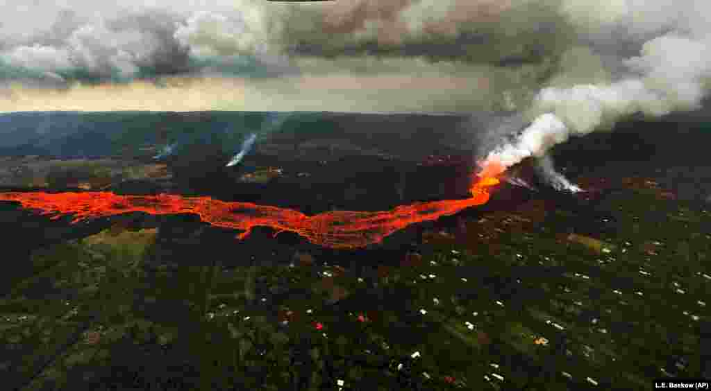 Lava from the Kilauea volcano flows in and around Pahoa, Hawaii. (AP/L.E. Baskow)