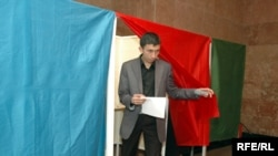 A man leaves a polling booth at a polling station in Baku.