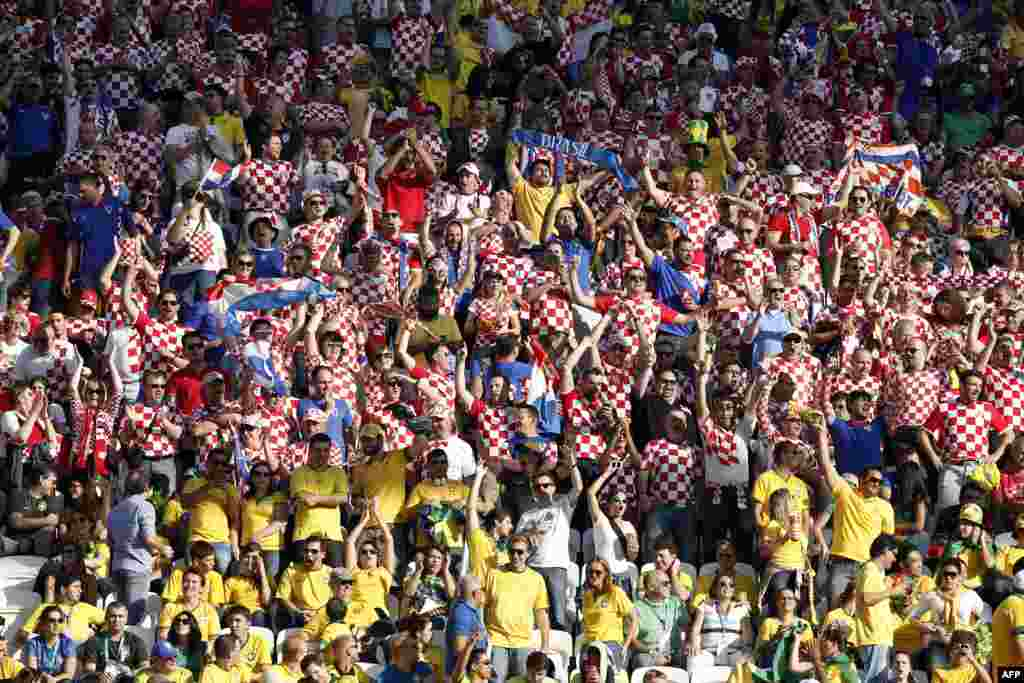 The crowd cheers berfore the Group A match between Brazil and Croatia at the Corinthians Arena in Sao Paulo after the opening ceremony.