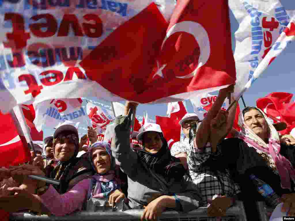 Supporters of Turkish Prime Minister Recep Tayyip Erdogan, the leader of Turkey's ruling Justice and Development Party (AKP), attend a rally in the southeastern city of Diyarbakir on September 3. Turks voted in a referendum on September 12, approving reforms aimed at bringing the constitution into compliance with European Union standards. Photo by Umit Bektas for Reuters