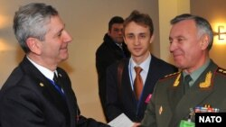 Admiral Giampaolo Di Paola (left), chairman of the NATO Military Committee, greets Russian Chief of Staff General Nikolai Makarov in Brussels.