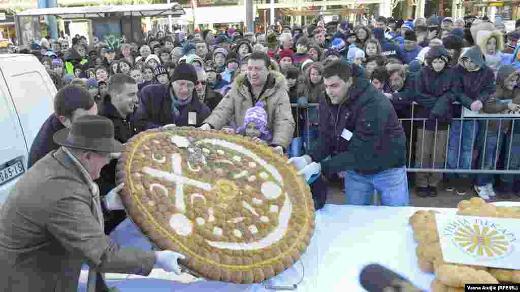Sharing traditional Christmas bread in downtown Belgrade. Young Tijana Stevanovic found the coin in the bread, signaling good luck in the next year.