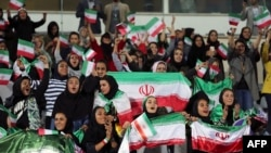 A group of hand-picked Iranian women were admitted to the stadium to watch a friendly football match between Iran and Bolivia at the Azadi Stadium in Tehran, October 16, 2018