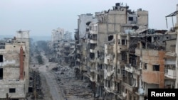 Pamje nga një pjesë e qytetit Homs e shkatërruar nga lufta në Siri