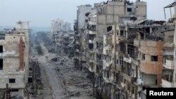 Пошкоджені будівлі сирійського Хомса, 27 січня 2014 року