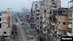 Пошкоджені будинки в сирійському місті Хомс, 27 січня 2014 року