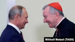 Russian President Vladimir Putin (left) meets with Vatican Secretary of State Cardinal Pietro Parolin in Sochi on August 23.