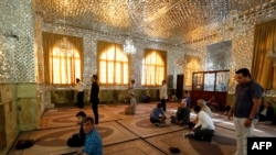 Iranian men pray during the holy fasting month of Ramadan in Emamzadeh Saleh mosque on Tajrish square in northern Tehran, June 7, 2016,