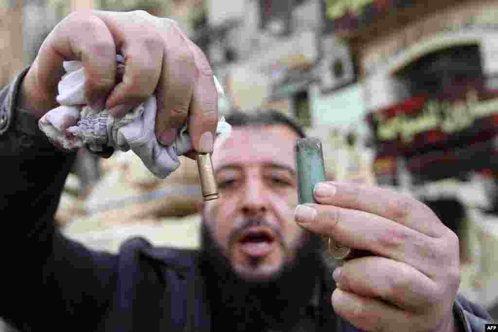 An Egyptian man displays empty bullet cartridges in Cairo's Tahrir Square on January 29, 2011.