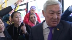 Kazakh Mothers Protest At Forum, Bused Away To Meet Mayor