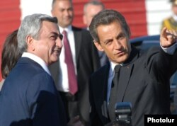 Armenia - French President Nicolas Sarkozy is greeted by his Armenian counterpart Serzh Sarkisian at Yerevan airport, 06Oct2011.