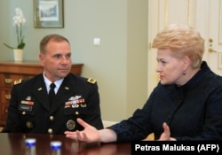 Lithuanian President Dalia Grybauskaite (right) during talks with U.S. Army Europe Commander Ben Hodges in Vilnus on September 1.