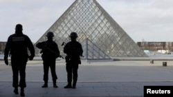 French police secure the site near the Louvre Pyramid in Paris on February 3.