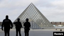 French police secure the site near the Louvre Pyramid in Paris following a machete attack on February 3 (file photo).