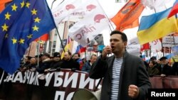 Russian opposition figure Ilya Yashin addresses supporters during a rally in Moscow on February 29.