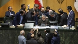 Iranian parliament speaker Ali Larijani, seated at center, speaks with a group of lawmakers in a session of parliament in Tehran, Iran, on Dec 02, 2018.
