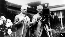 Амэрыканскія вынаходнікі Джордж Істмэн і Томас Эдысан, 1919