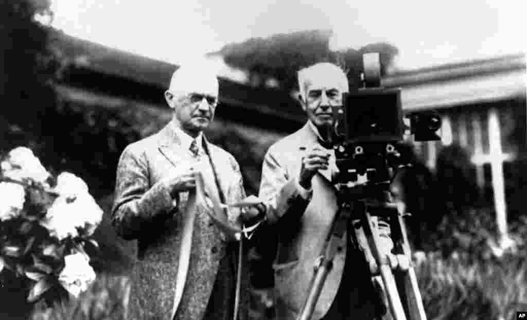Eastman Kodak founder George Eastman (left) and Thomas Edison pose with their inventions in December 1919. Edison invented motion-picture equipment and Kodak invented roll film and the camera box, both of which helped to create the motion-picture industry.