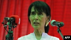 Aung San Suu Kyi addresses foreign and local journalists during a press conference held at her residence in Yangon on March 30.