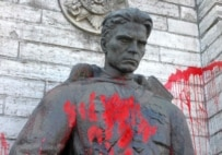 The Bronze Soldier, here vandalized in 2005, was moved from the city center to a cemetery (ITAR-TASS)