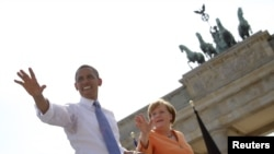Барак Обама и Ангела Меркель 19 июня у Бранденбургских ворот в Берлине