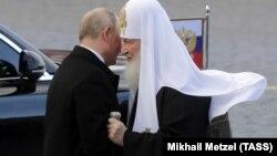 Президент Владимир Путин и патриарх Кирилл, ноябрь 2018 г.