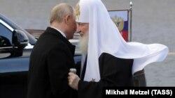Президент России Владимир Путин и патриарх Кирилл, 4 ноября 2018 года