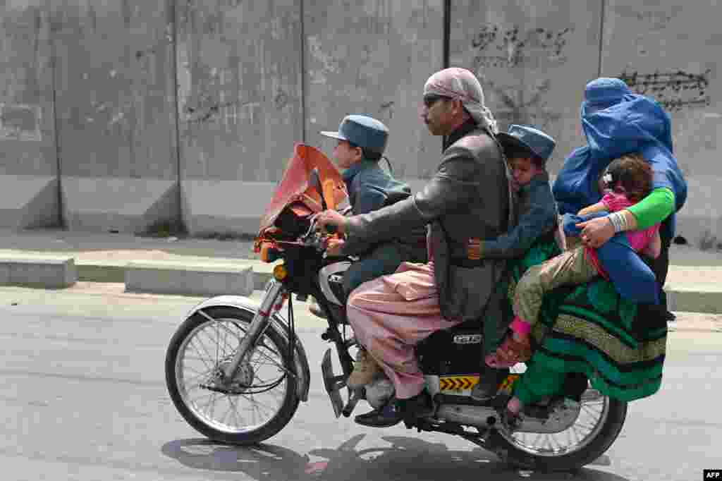 An Afghan family travel on a motorbike in Kabul. (AFP/Wakil Kosar)