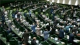 IRAN -- Iranian MPs chant anti U.S. slogans at the parliament in Tehran, May 9, 2018