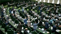 IRAN -- Iranian MPs chant anti U.S. slogans at the parliament in Tehran, May 9, 2018
