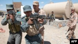 Afghan National Police are trained by a Czech provincial reconstruction team in Pul-e Alam in Logar Province in 2009.