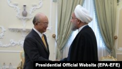 IRAN -- A handout photo made available by the presidential official website shows, Iranian President Hassan Rouhani (R) greeting Director General of the International Atomic Energy Agency (IAEA) Yukiya Amano (L), at the presidential office in Tehran, Ira