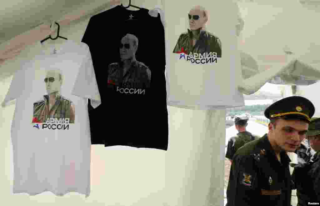 "T-shirts, displaying images of Russian President Vladimir Putin go on sale at a canteen during an event entitled ""Innovations Day,"" which was organized by Russia's Western military command at the Levashovo airbase outside St. Petersburg on June 6. (Reuters/Alexander Demianchuk)"