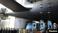 """Russian President Dmitry Medvedev delivers a speech during a ceremony launching the """"Severodvinsk,"""" a multipurpose nuclear submarine of the fourth generation, at Sevmash shipyard in Severodvinsk on June 15."""
