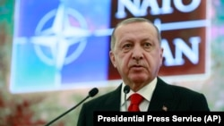 U.S. and NATO officials have called on Turkish President Recep Tayyip Erdogan to call off his Russian missile deal.