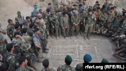 FILE: Afghan National Army soldiers planning an operation against militants in Kunduz.