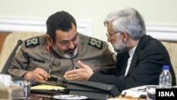 حسن فیروزآبادی (سمت چپ) همراه با سعید جلیلی در نشست مجمع تشخیص مصلحت نظام.