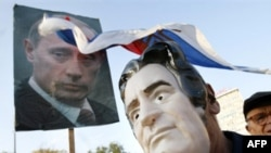 Bosnian Serb man wears a mask in the likeness of war crimes indictee Radovan Karadzic during a protest in Banja Luka in September