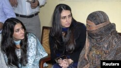 The daughter and wife of the governor of Punjab Province speak to Aasia Bibi (right), who has been sentenced to death for blasphemy