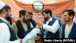 FILE: A polio vaccination campaign in Helmand in late September.