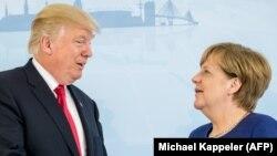 Дональд Трамп (слева) и Ангела Меркель. Гамбург, Германия, 6 июля 2017 года.