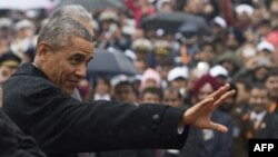 U.S. President Barack Obama waves as he arrives to attend India's Republic Day Parade in New Delhi.