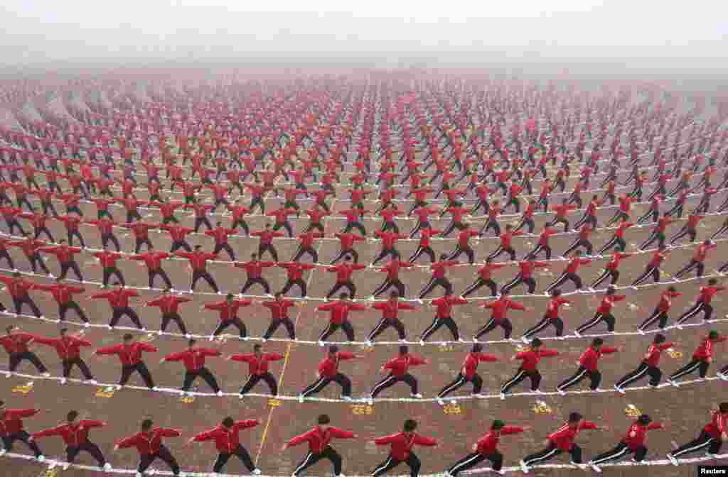 Chinese students perform during a founding ceremony of a soccer team of Shaolin Tagou martial arts school in Dengfeng, Henan Province. (Reuters/China Daily)
