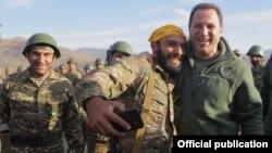 Armenia -- An Armenian army reservist takes a selfie with Defense Minister Davit Tonoyan (R) during a military exercise, September 30, 2019.