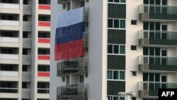 A Russian flag is displayed at the Olympic village for athletes in Rio de Janeiro.